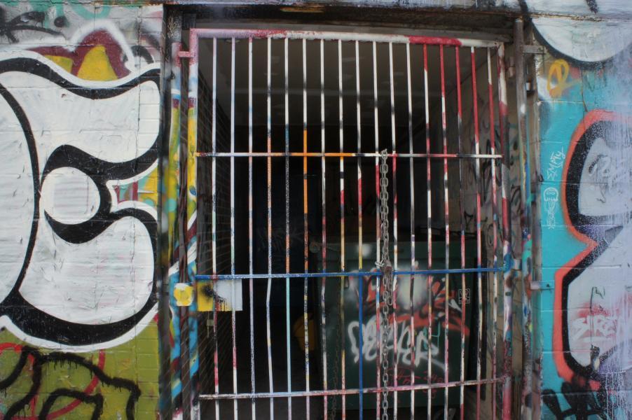 a photograph of bars and graffiti taken by Jennifer N. Shannon