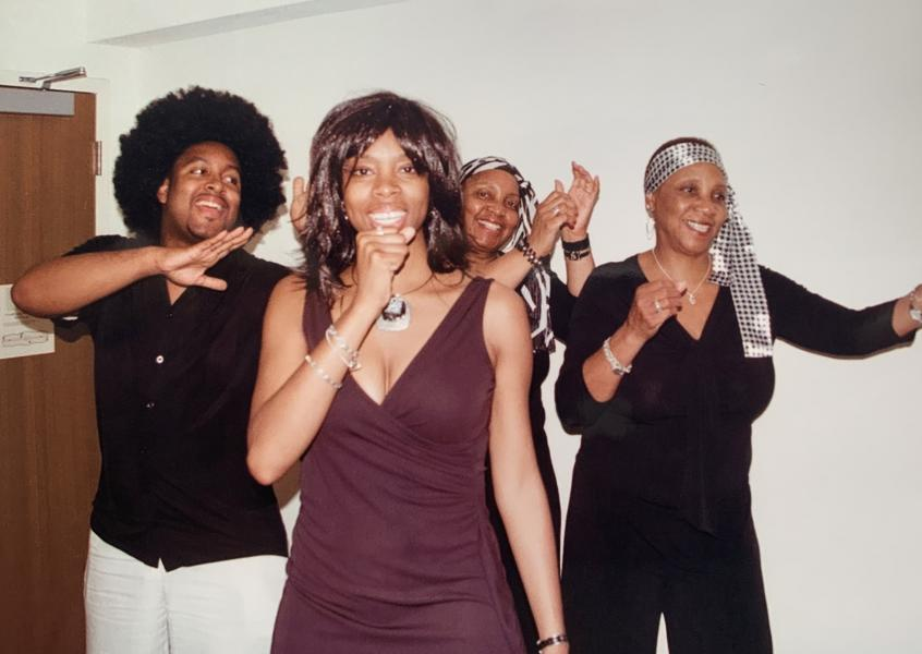 Four family members practicing a performance as Tina Turner, Ike and the Ikettes