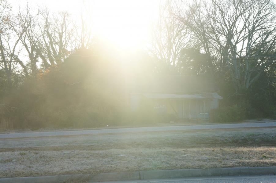 a photograph of the sun, brightly shining on top of an abandoned house, taken by Jennifer N. Shannon