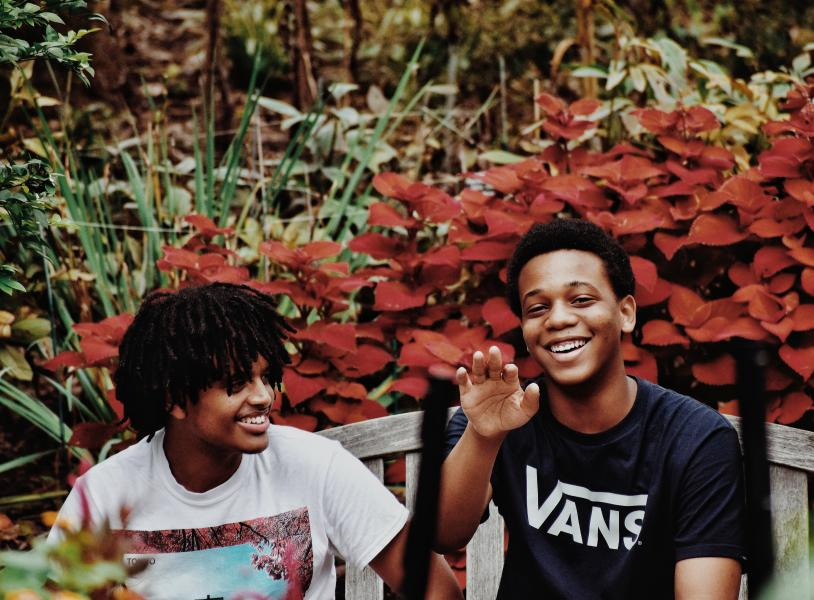 Two black young men, smiling and happy