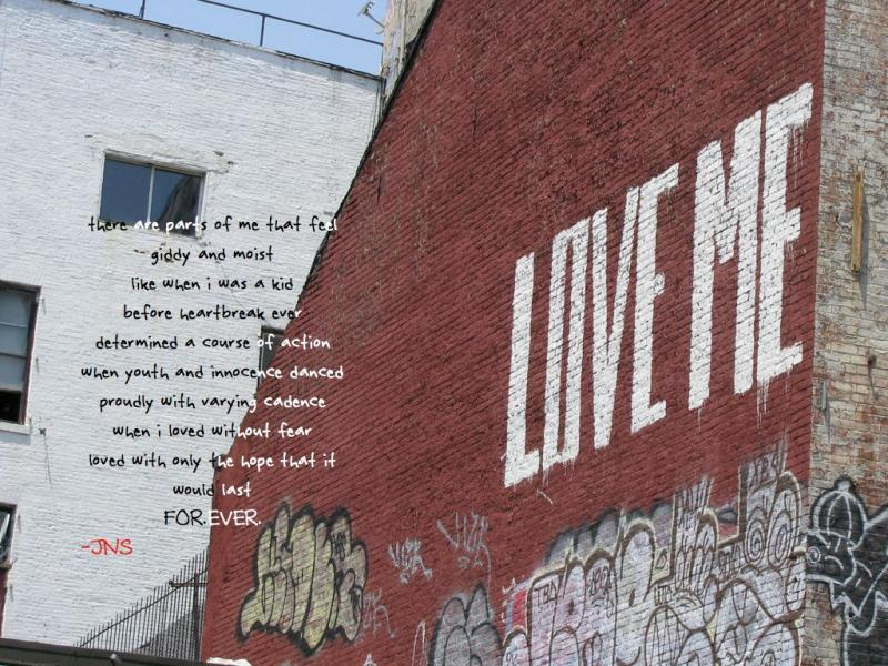 a photograph of the side of a building that has LOVE ME painted on it, taken by Jennifer N. Shannon
