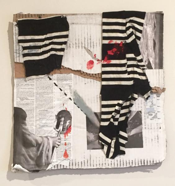 A mixed media artwork with white cardboard, black fabric, red paint splatters, and images from Isle of the Dead 1945.