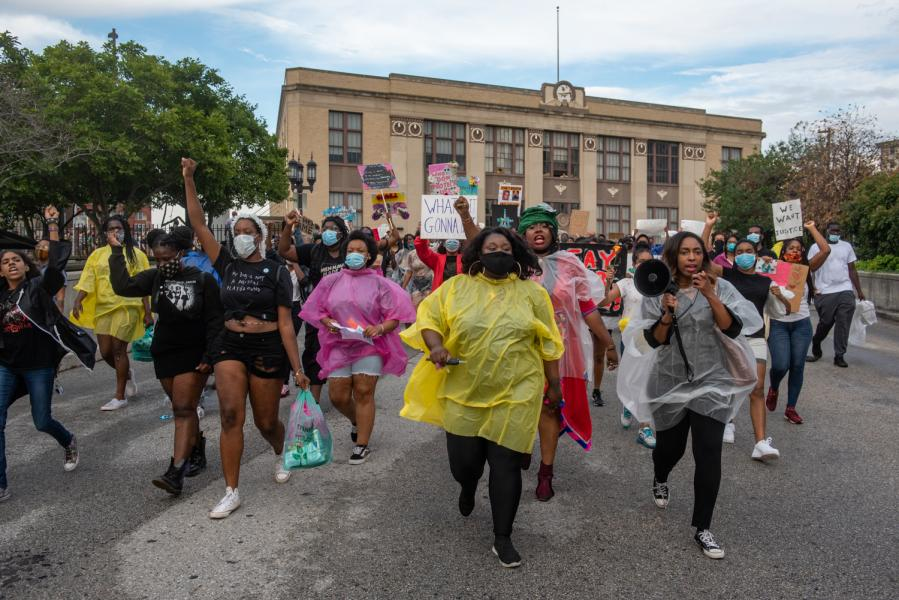 Black Womyn marching past penn station demanding justice for Black Womyn who have been brutalized by cops.