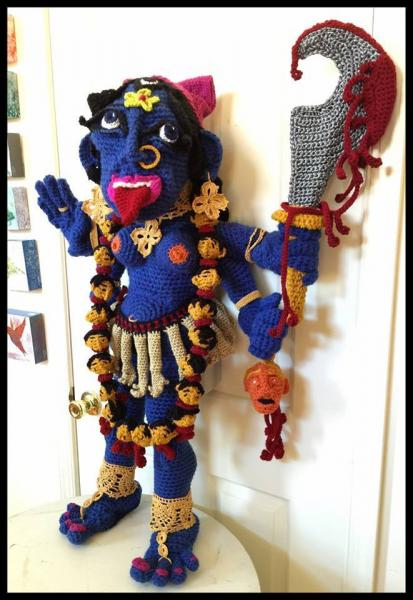 Kali, the goddess of Time, Creation, Destruction and Power has now nearly completed her manifestation. Her right hands form the abhaya (fearlessness) and varada (blessing) mudras. Her left hands hold the sword of divine knowledge which has chopped off the