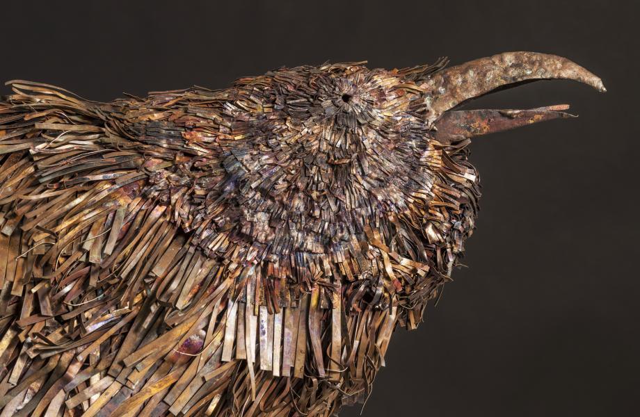 "Raven-the orator: ideogram: woodland eyes/beak, dense leaf pattern copper, stainless steel 29"" x 40"" x 10"""