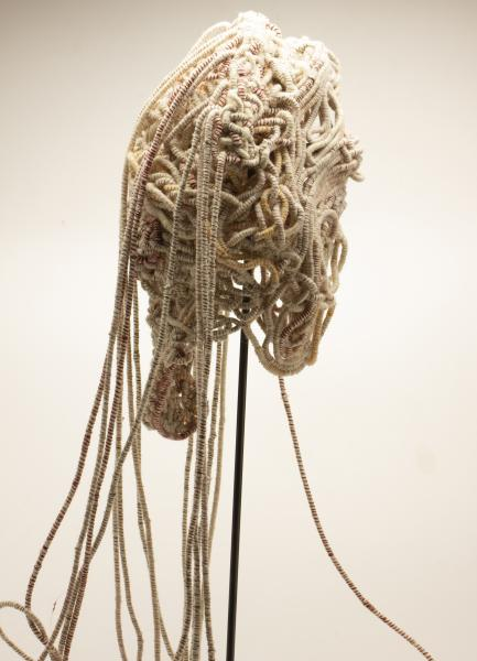 Coiled Mask 4 (profile, zoomed out), thread and rope, 2021, 60 x 15 x 11 inches
