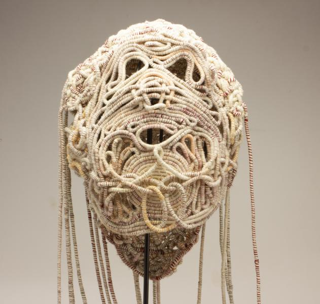 Coiled Mask 4, thread and rope, 2021, 60 x 15 x 11 inches