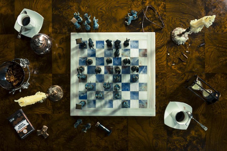 "Photograph of ""Chess, Coffee, & Chocolate."""