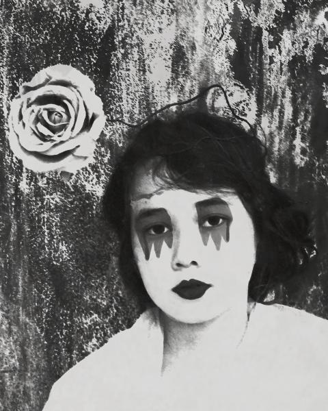Black and white photograph of  girl with rose