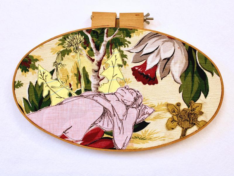 Dream, freehand machine stitched figure, on  vintage barkcloth