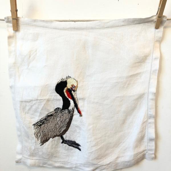 Hand embroidered , brown pelican, endangered birds, thread painting, installation, fiber art , environmental art