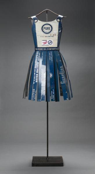 Team Pure Oil, Made of vintage oil cans and steel. Resembling a vintage cheerleader's outfit.