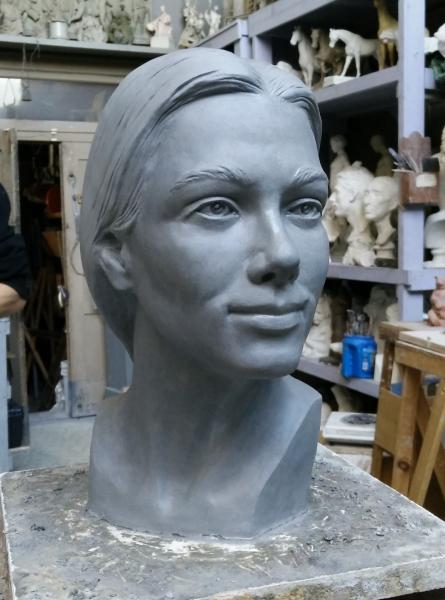 Life sized clay bust of a woman.