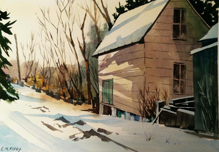 Raking shadows across a barn in a snow scene in Frostburg, MD