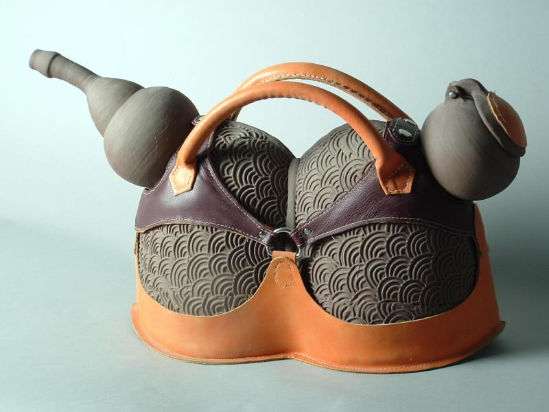Fired-clay, terra-sigilata, leather, metal-rivets, and cotton-thread.