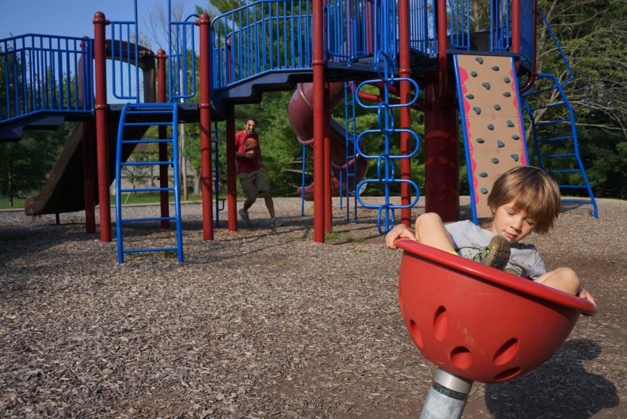 Boy Spinning on Playground