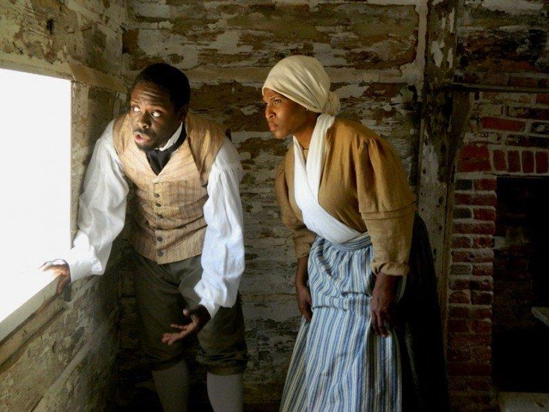 Two enslaved house servants debate whether to make a run to the British, who offer freedom