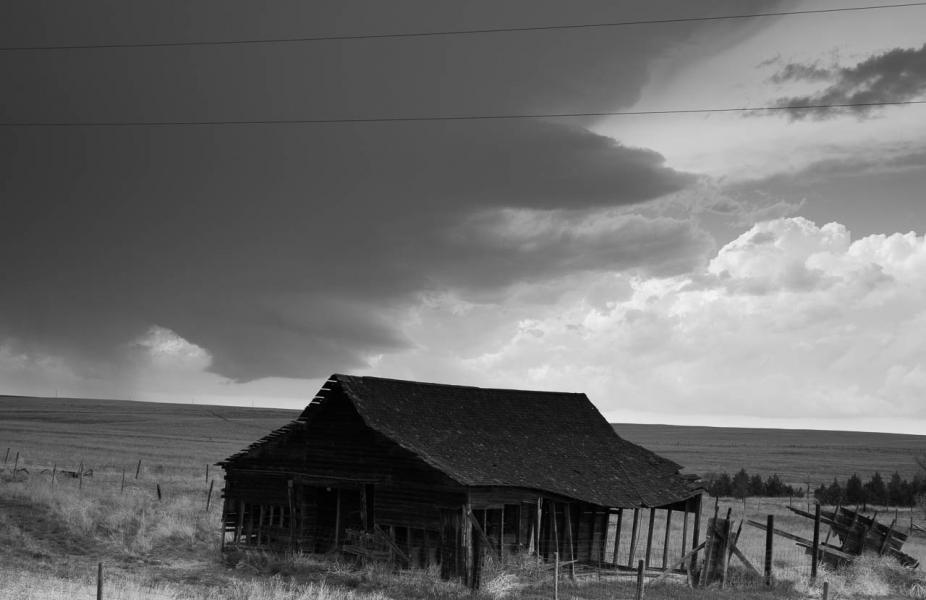 Weathered barn beneath ominous clouds on the high plains of Colorado