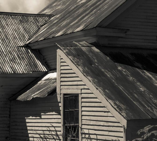 Sharp angles and deep shadows of a New England farmhouse