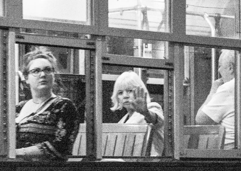 Passenger reacts to a photographer on a New Orleans trolley.