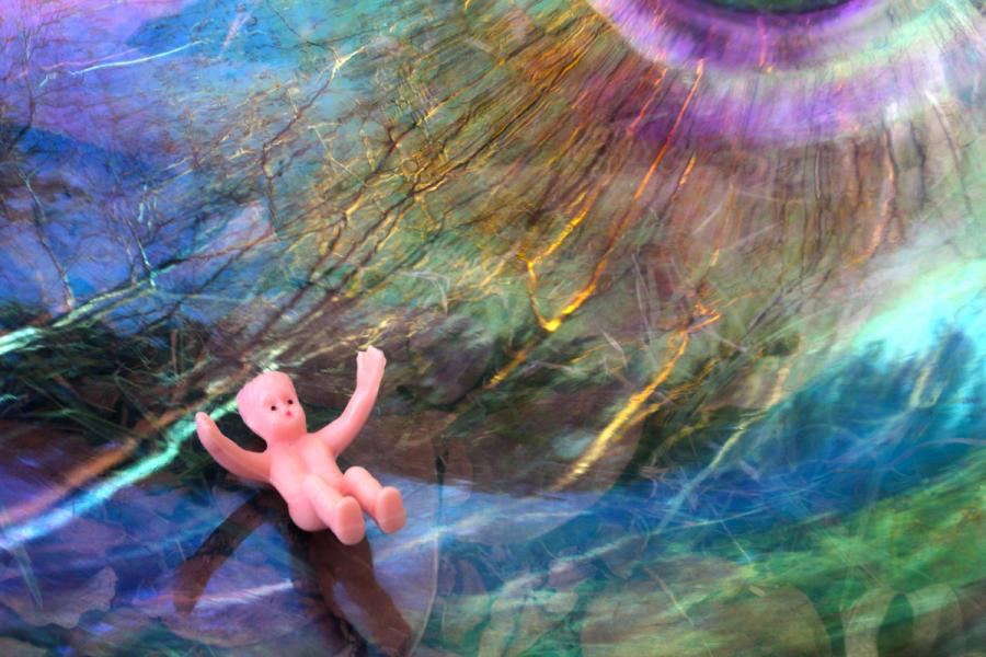 Plastic baby in abstract environment