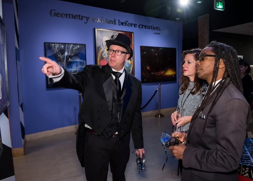 Jim Doran explaining something to two nice people in a musuem
