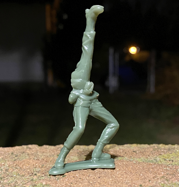 Melted toy Army man with a leg for an upper body