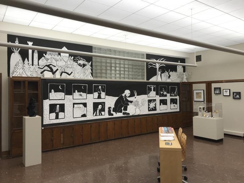 Installation at the Greenbelt Cultural Center, with several long drawings, shadow boxes and dioramas.