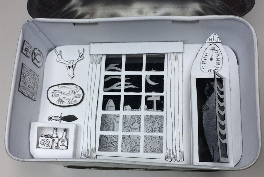 Cut paper diorama in a tea tin showing a sitting room and grandmother clock