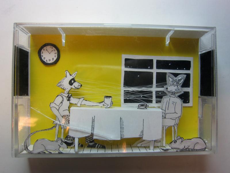 Cut paper diorama in a tape cassette box