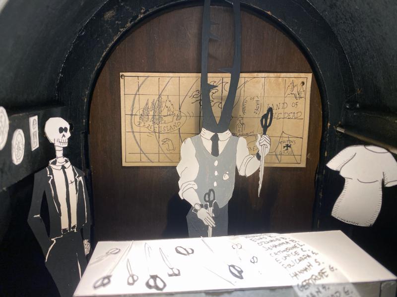 cut paper diorama in a mantle clock