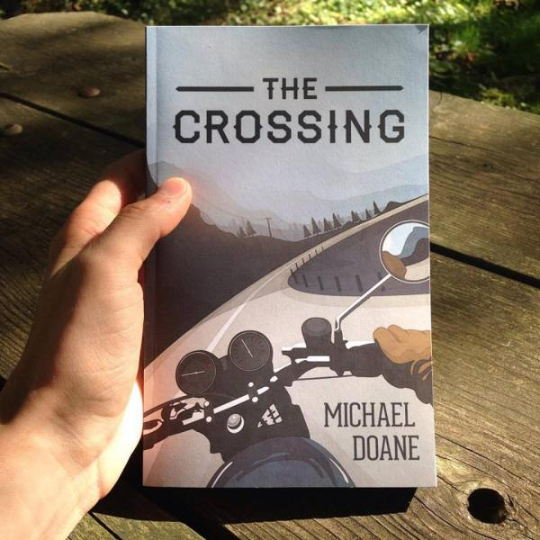 Proud moment of Michael Doane holding his first copy of The Crossing.
