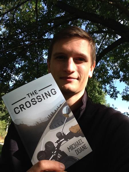 Another proud moment of Michael Doane with his first printed copy of The Crossing.