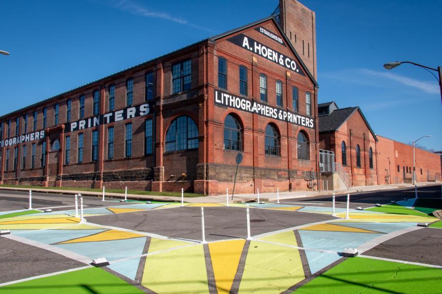 Collington Square Oak Wisdom Crosswalks perspective view with Hoen Lithograph building