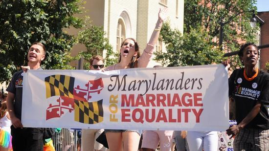 "Image of people marching in a parade. They are holding a sign that reads ""Marylanders for Marriage Equality."""